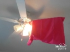Pillow case over ceiling fan blade